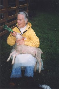 Anne Priest with bottle lamb at home in New York State